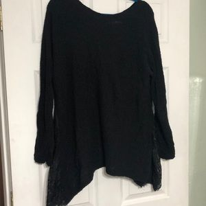 Black asymmetrical sweater with lace inserts